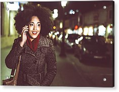 Smiling Young Woman Using Phone On Street By Night Acrylic Print by Portishead1