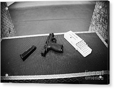 Smith And Wesson 9mm Handgun With Ammunition At A Gun Range In Florida Usa Acrylic Print by Joe Fox