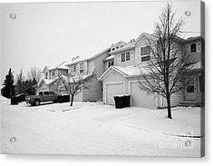 snow falling in residential street during winter Saskatoon Saskatchewan Canada Acrylic Print by Joe Fox
