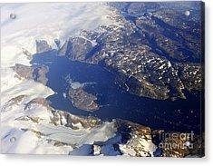 Snowy Rocky Coastline And Floating Icebergs On Ocean Acrylic Print by Sami Sarkis