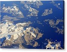 Snowy Rocky Islands And Floating Icebergs On Ocean Acrylic Print by Sami Sarkis