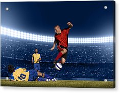 Soccer Player Jumping With Ball Acrylic Print by Kycstudio