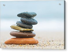 Stack Of Beach Stones On Sand Acrylic Print by Michal Bednarek