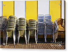 Stacks Of Chairs And Tables Acrylic Print by Carlos Caetano