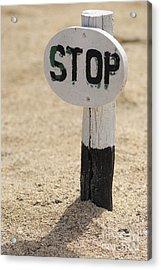 Stop Sign On Sand Acrylic Print by Sami Sarkis
