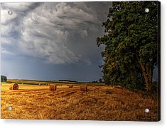 Storm Clouds Over Harvested Field In Poland Acrylic Print
