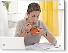 Student Eating Cereal Acrylic Print by Science Photo Library