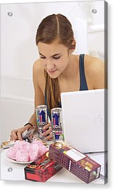 Student Eating Sugary Snacks Acrylic Print by Science Photo Library