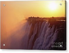Sunset Over The Victoria Falls Acrylic Print by Alex Cassels