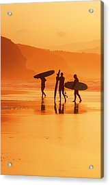 surfers at sunset in Sopelana Acrylic Print by Mikel Martinez de Osaba