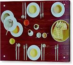 Tableware Set On A Wooden Table Acrylic Print by Romulo Yanes