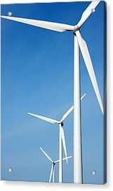 Three Mighty Windmills In A Row Against A Blue Sky. Acrylic Print