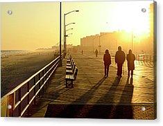 Three People Walking Down Boardwalk Acrylic Print by Copyright Eric Reichbaum