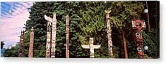 Totem Poles In A Park, Stanley Park Acrylic Print by Panoramic Images