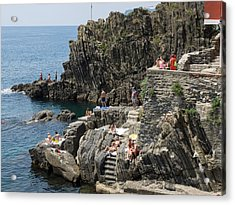 Tourists Sunbathing On The Rocks Acrylic Print by Panoramic Images