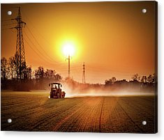 Tractor In A Field At Sunset Acrylic Print by Rinocdz