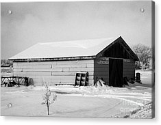 traditional wooden plank barn in rural village Forget Saskatchewan Canada Acrylic Print by Joe Fox