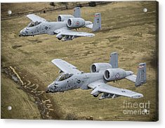 Two A-10 Thunderbolt IIs Conduct Acrylic Print by Stocktrek Images