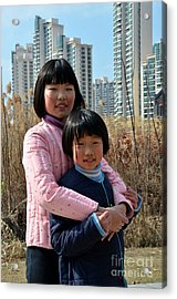 Two Chinese Teen Sisters Hug  And Embrace Shanghai China Acrylic Print by Imran Ahmed