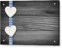 Two Hearts Laying On Wood Acrylic Print by Aged Pixel