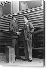Two Men Shaking Hands At Train Acrylic Print by Underwood Archives