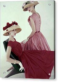 Two Models Wearing Red Dresses Acrylic Print by Karen Radkai