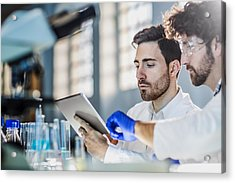 Two Scientist Using Digital Tablet In Laboratory Acrylic Print by Poba