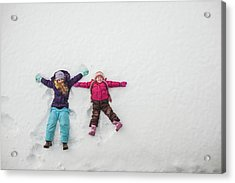 Two Sisters Playing, Making Snow Angels Acrylic Print by Hugh Whitaker