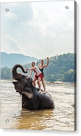 Two Young Women Riding An Elephant In The Mekong Acrylic Print by Matteo Colombo