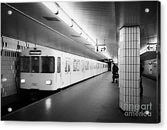 u-bahn train pulling in to ubahn station Berlin Germany Acrylic Print
