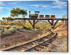 Under The Mining Cars Acrylic Print by Eddie Yerkish