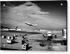 united airlines aircraft taking off taxiing and on stand at the San Francisco International Airport  Acrylic Print by Joe Fox