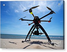 Unmanned Aerial Vehicle On Beach Acrylic Print by Sami Sarkis