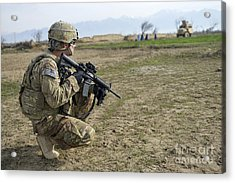 U.s. Soldier Patrols A Village Acrylic Print by Stocktrek Images
