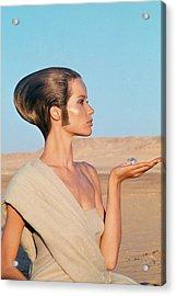 Veruschka Von Lehndorff Sitting In A Desert Acrylic Print by Franco Rubartelli