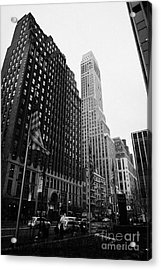 view of pennsylvania bldg nelson tower and US flags flying on 34th street from 1 penn plaza Acrylic Print by Joe Fox