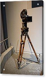 Vintage Movie Camera On Tripod Acrylic Print by Paul Ward