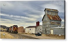 Warbonnet Passing The Grain Elevator Acrylic Print by Ken Smith
