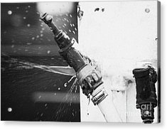Water Escaping From A Loose Fitting Hose And Tap On Orange Post Kilkeel Harbour County Down Northern Ireland Acrylic Print by Joe Fox