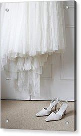 White Shoes On Floor Beneath Wedding Dress Hanging Outside Wardrobe Acrylic Print by Michael Blann
