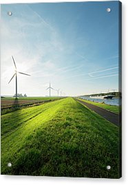 Wind Turbines And Canal, Bath, Zeeland Acrylic Print by Mischa Keijser