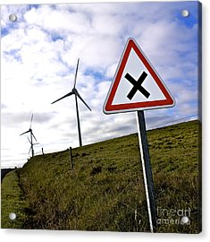 Wind Turbines On The Edge Of A Field With A Road Sign In Foreground. Acrylic Print by Bernard Jaubert