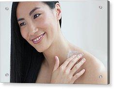 Woman Applying Body Cream Acrylic Print by Ian Hooton