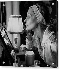 Woman Applying Face Cream Acrylic Print