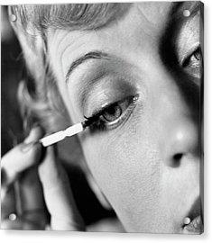 Woman Applying Mascara Acrylic Print