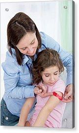 Woman Applying Plaster To Girl's Arm Acrylic Print