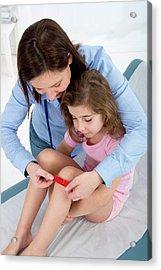 Woman Applying Plaster To Girl's Knee Acrylic Print