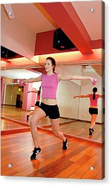 Woman Exercising In A Gym Acrylic Print by Aj Photo/science Photo Library