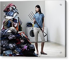 Woman Next To Pile Of Laudry With Pitchfork. Acrylic Print by Ryan McVay