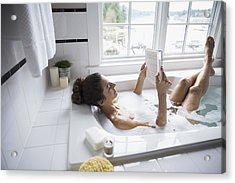 Woman Reading Book In Bubble Bath Acrylic Print by Hero Images